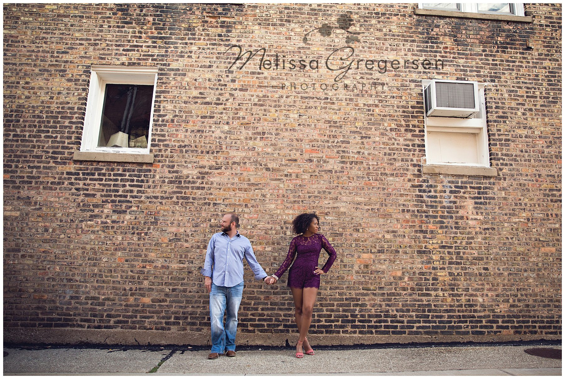 Gorgeous engagement photos with textured brick wall in St. Joseph Michigan
