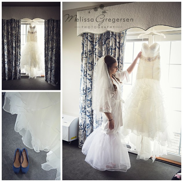 Bride admiring wedding dress in Bridal Suite at Bay Pointe Inn on Gun Lake Michigan photographed by Gregersen Photography