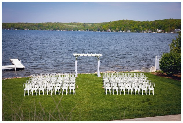 Wedding Ceremony site in the summer time at Bay Pointe Inn on Gun Lake photographed by Melissa Gregersen Photography