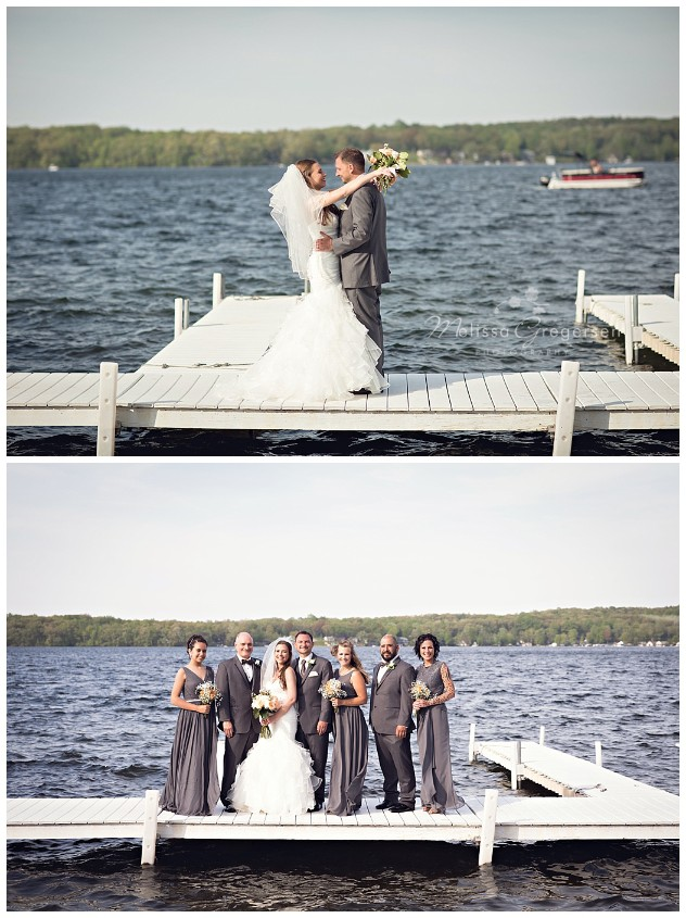 Bride and groom on the dock at Gun Lake for their Bay Pointe Inn Wedding