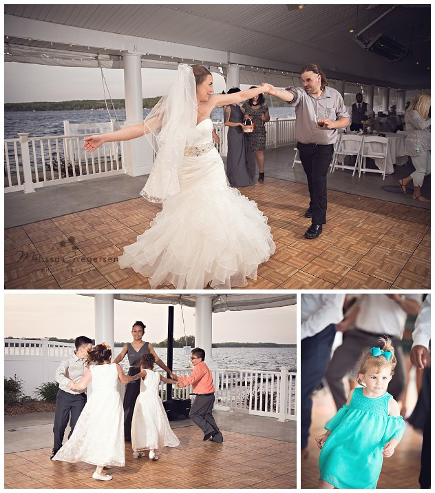 Fun reception dancing time as the sunsets at Bay Pointe Inn on Gun Lake photographed by Melissa Gregersen Photography