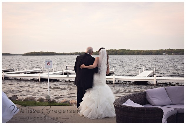 Father and bride share a special moment at sunset on her wedding day at Bay Pointe Inn on Gun Lake photographed by Melissa Gregersen Photography