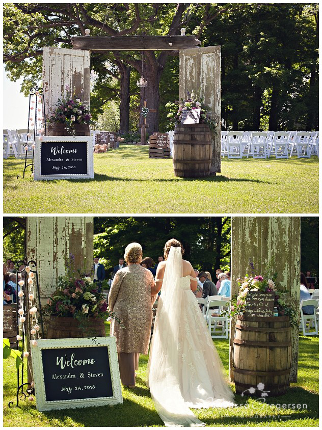 Wedding ceremony site at the vintage rose barn with rustic barn doors and barrels