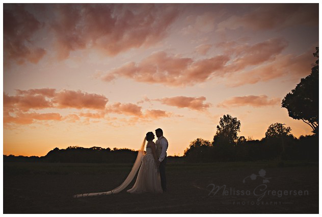 Ending the perfect wedding day being photographed under the sunset