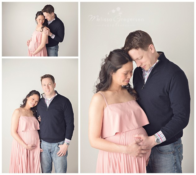 Husband and wife anticipating new little one at studio photography session for maternity pictures