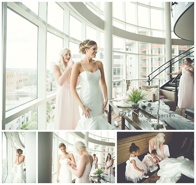 bride getting ready with the help of the brides maids in the Radisson Grand Loft Suite in downtown Kalamazoo