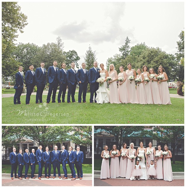 The dark blue suits of the groomsmen and the pale pink of the bridesmaids dresses made for an amazing bridal party portrait.