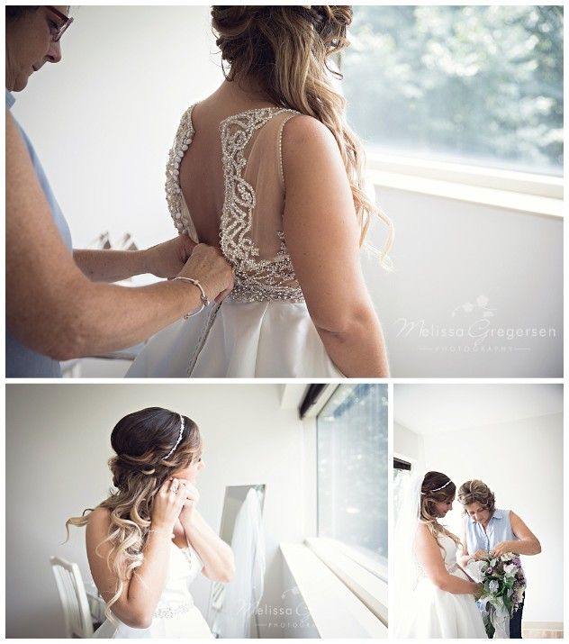 Beautiful bride putting the finishing touches to her look for the big day at the Fetzer Center.