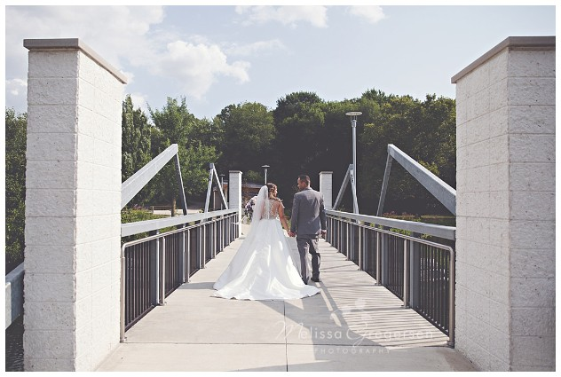 Bride and Groom taking a walk on the bridge at the Fetzer Center