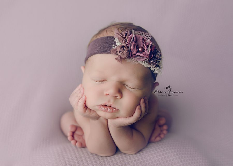 newborn on purple blanket in froggie pose at Gregersen Photography Studio