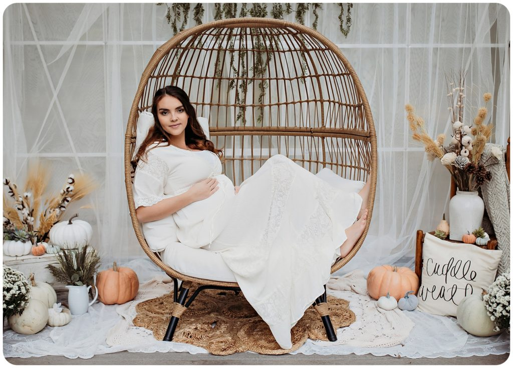 Maternity photography session with egg chair from Target